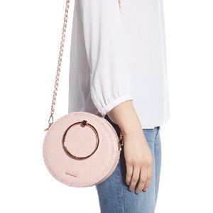 Round, pink purse- champagne colored handle/chain